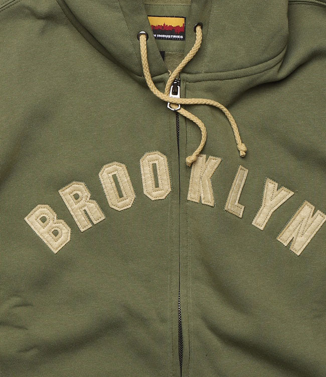 DETAIL OF APPLIQUE LETTERING OF BROOKLYN IN AN ARCH ON THE CHEST
