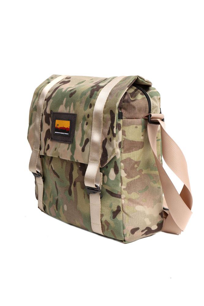 side view of arid camo mail bag with strap in khaki