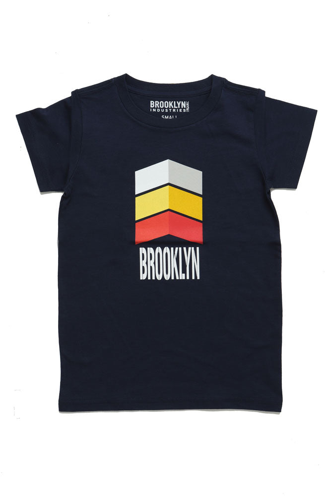 YOUTH SIZED BROOKLYN ARROW TSHIRT IN A FLAT LAY. RETRO DESIGN IN WHITE YELLOW AND RED