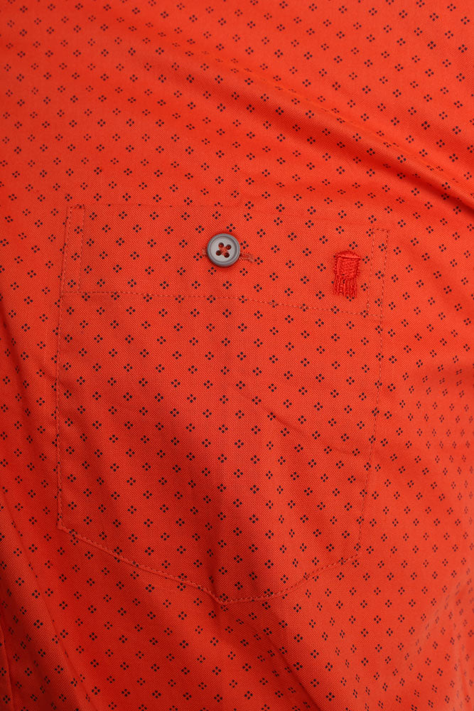 detail of front pocket and water tower embroidery on men's short sleeve woven shirt in an orange red with blue dot details