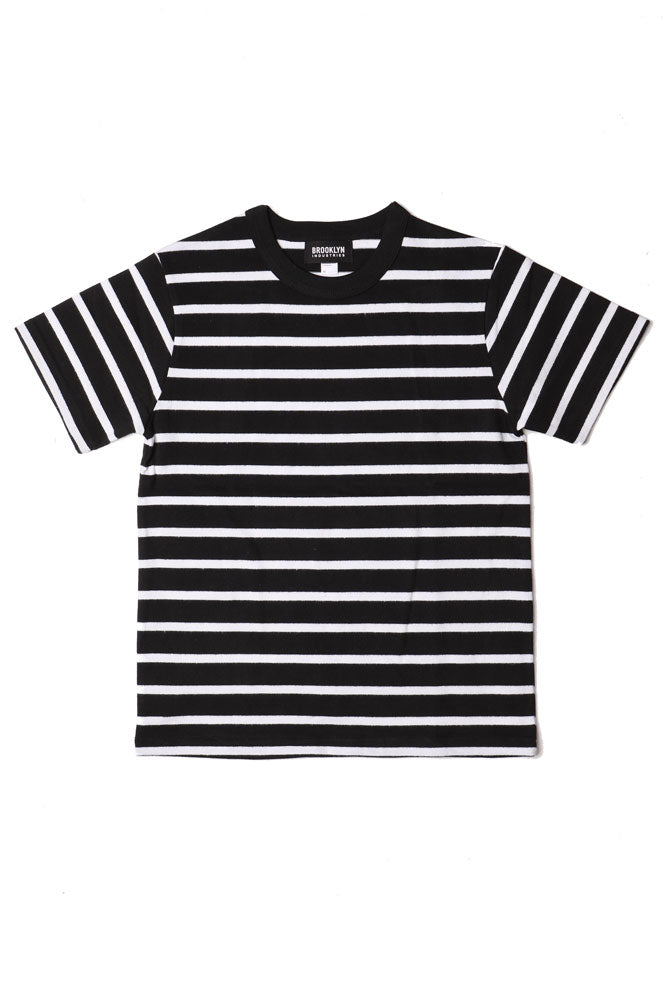 flat lay of knit black and white striped men's short sleeve shirt