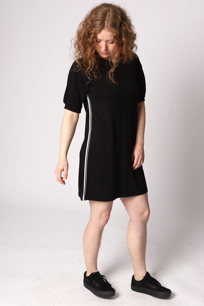 The Baby Doll is a soft French terry shift dress with short puff sleeves and an athletic side stripe detail.