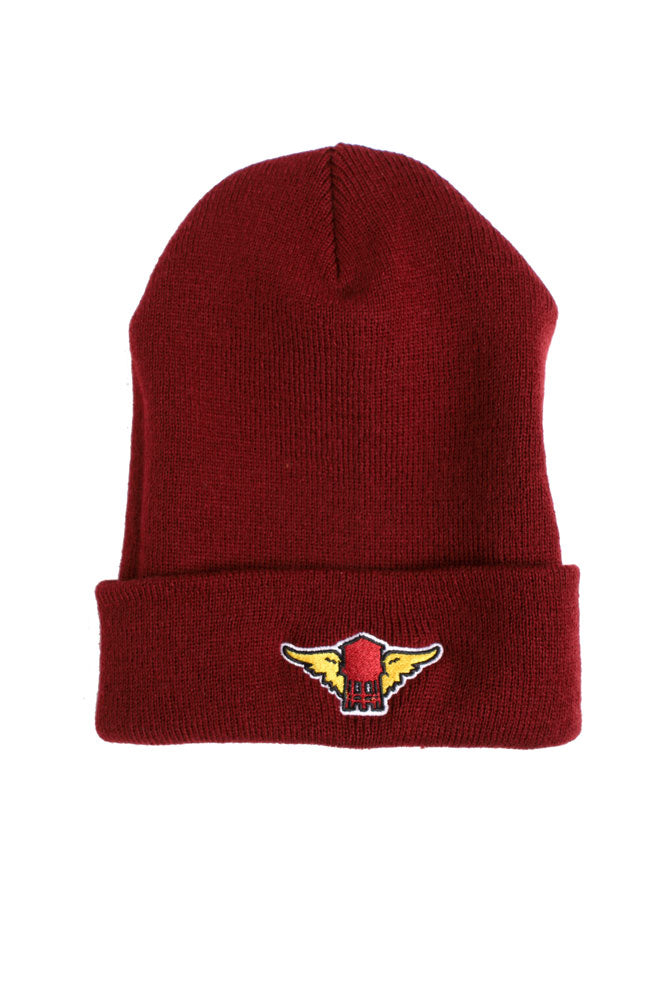 flat lay of maroon knit cap with red water tower with yellow wings patch