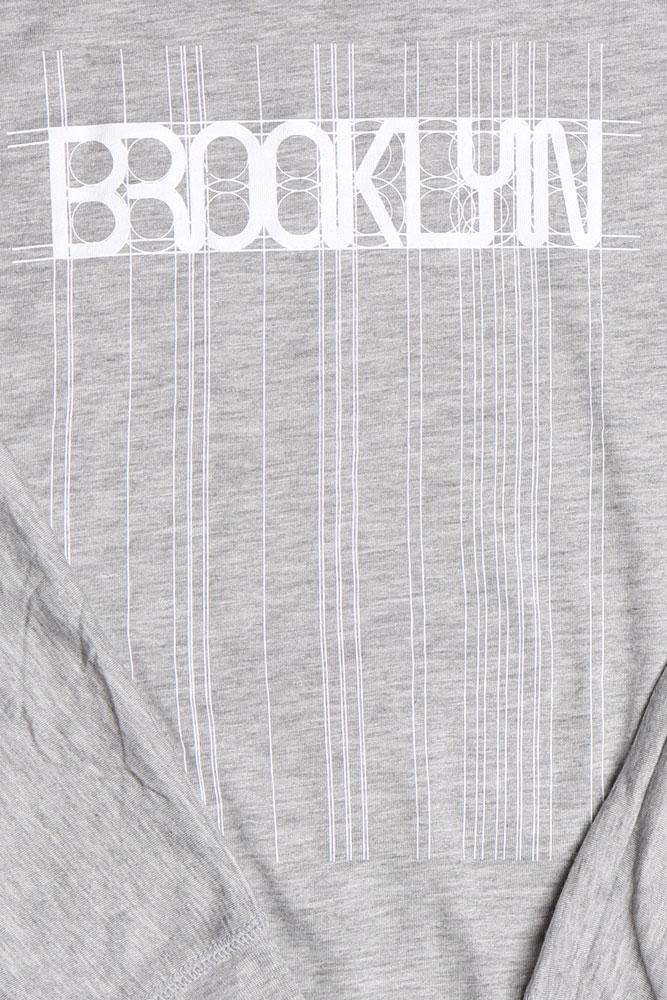 detail of grey long sleeve with Brooklyn graphic in white, lines and detail extending the entire length of the shirt