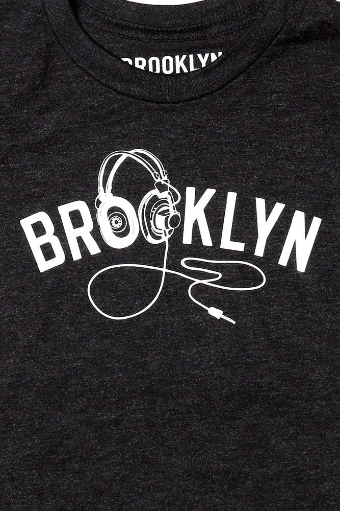 DETAIL OF GRAPHIC ON YOUTH SIZE BK PHONES T-SHIRT IN BLACK