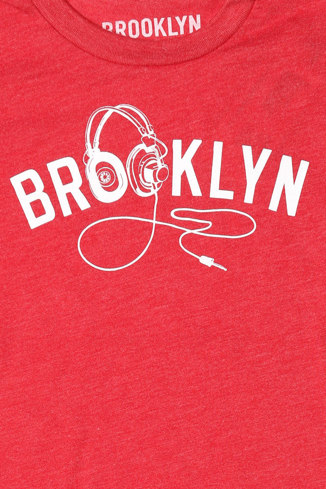 DETAIL OF GRAPHIC ON YOUTH SIZE BK PHONES T-SHIRT IN RED