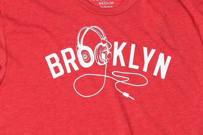 DETAIL OF GRAPHIC ON BK PHONES MEN'S T-SHIRT IN VINTAGE RED