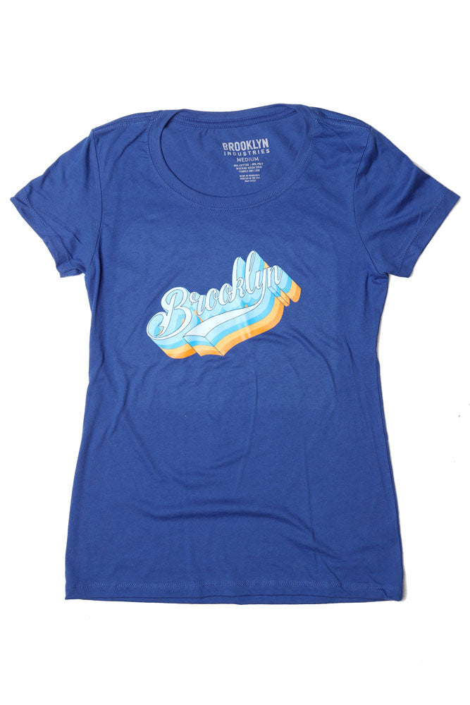 FLAT LAY ROYAL BLUE WOMEN'S GRAPHIC T-SHIRT WITH THE RETRO STYLE BK PLATFORM GRAPHIC ON THE CHEST
