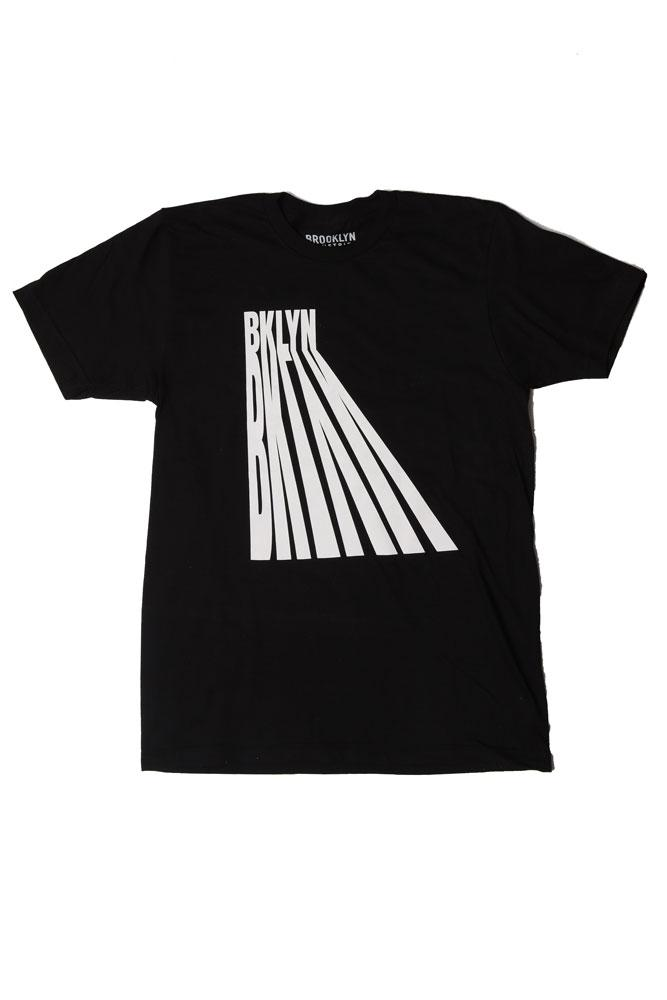 FLAT LAY BLACK T-SHIRT WITH THE TEXT OF BKLYN CASTING ITS OWN SHADOW IN WHITE