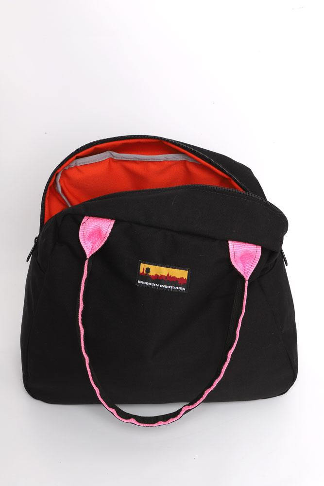 MEDIUM BOWLING BAG OPEN TO SHOW LINING COLOR.. BLACK WITH ORANGE LINER