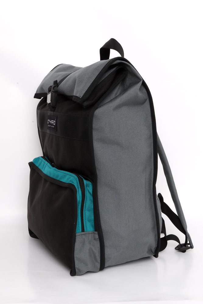 SIDE VIEW CRYPTO RADAR BACK PACK WITH FRONT POCKET AND ROLL TOP, IN BLACK WITH GREY AND TEAL DETAILS