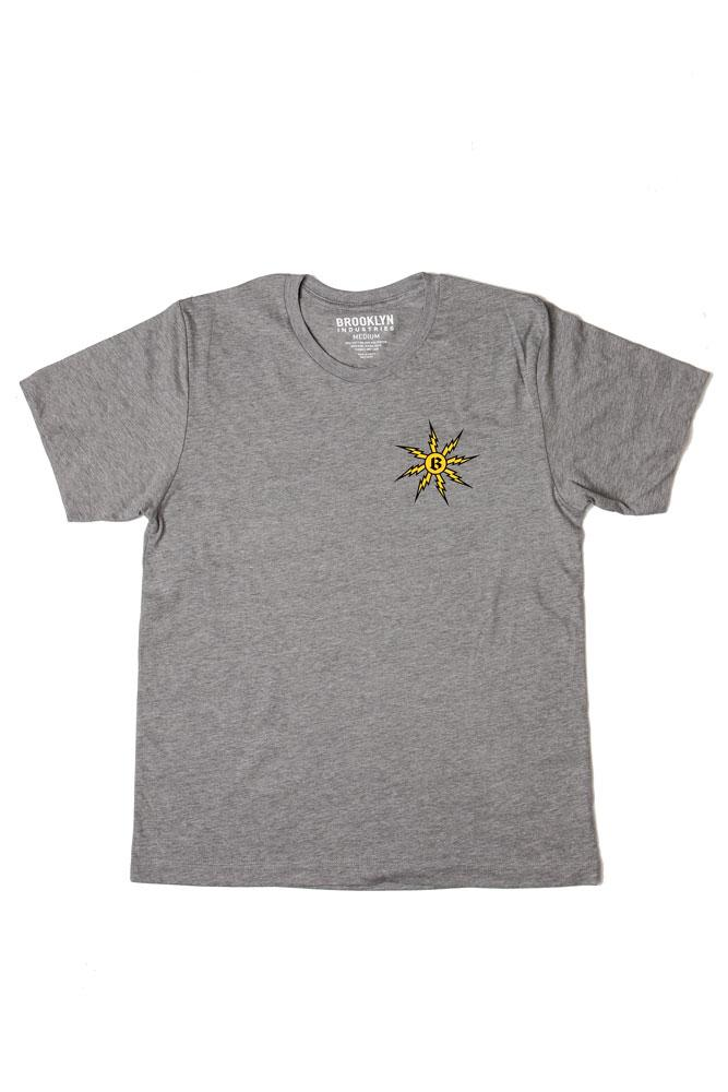 flat lay grey t-shirt with yellow lightening bolts in a circle, striking the letter b, on the left chest