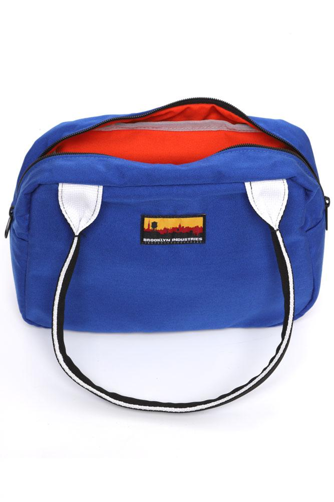 BOWLING BAG FRONT VIEW BLUE OPEN, SHOWING ORANGE LINER.