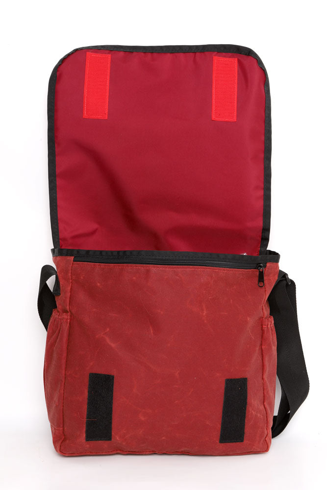 COURIER STYLE MESSENGER BAG OPEN WITH TOP BACK SHOWING RED LINER OF  BURGUNDY WAX BAG