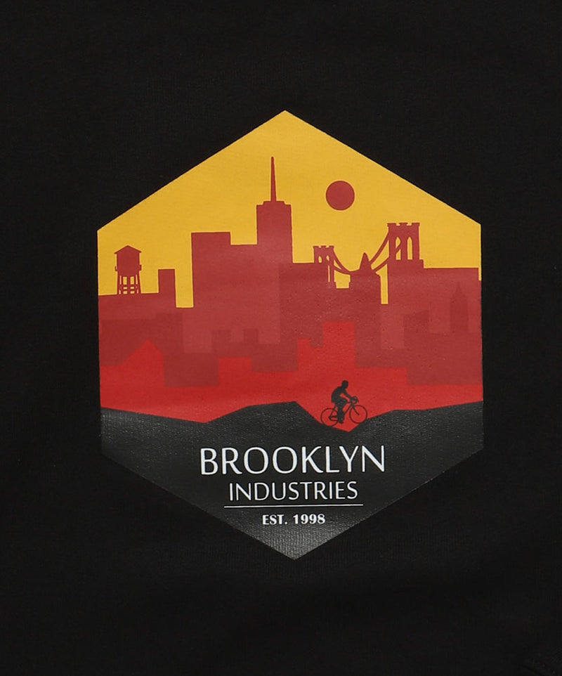YELLOW AND REDS IN HEXAGON GRAPHIC BROOKLYN INDUSTRIES SKYLINE, WITH BIKER.