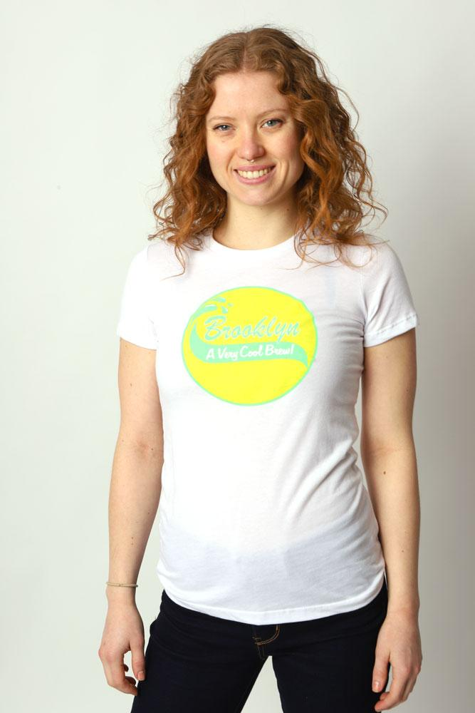 Closer view of smiling women wearing cool brew graphic t-shirt in white