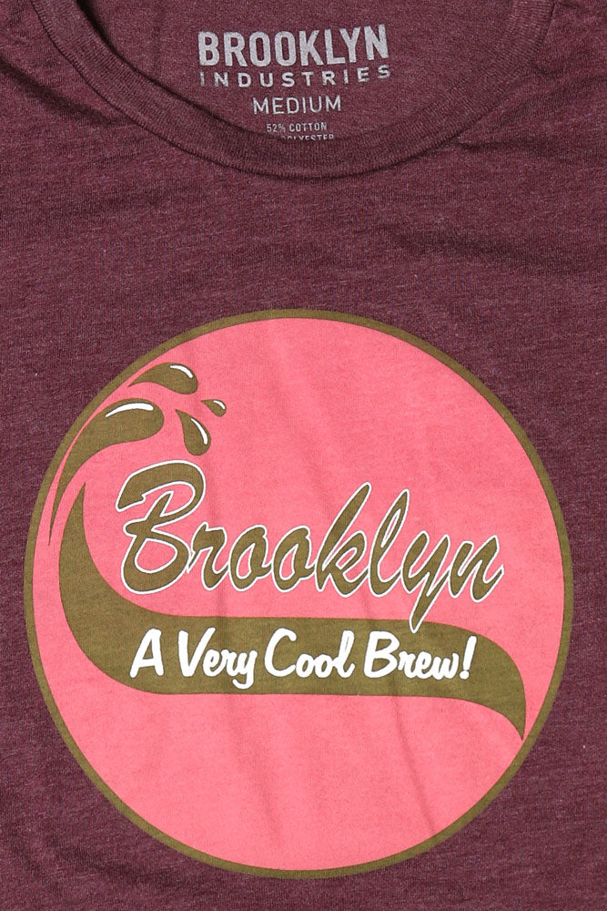 DETAIL OF PINK COOL BREW GRAPHIC ON MAROON T-SHIRT