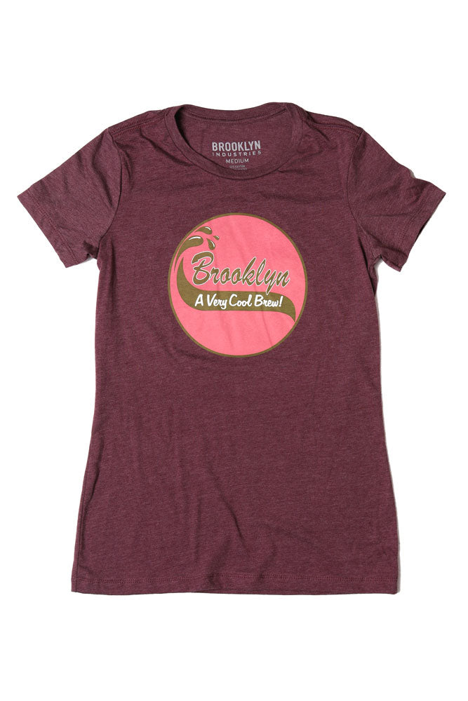 FLAT LAY MAROON WOMEN'S T WITH PINK GRAPHIC CIRCLE IN THE MIDDLE