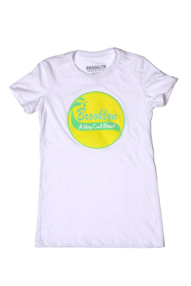 FLAT LAY WHITE WOMEN'S T WITH LIME AND YELLOW GRAPHIC CIRCLE IN THE MIDDLE