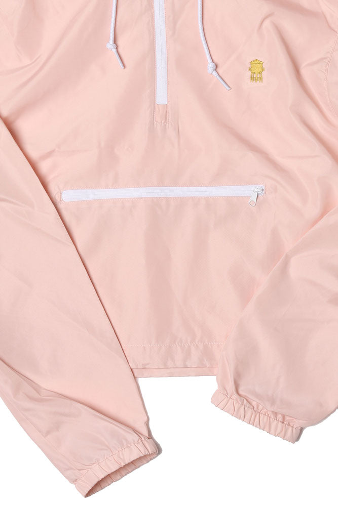 CROPPED WIND BREAKER IN BLUSH WITH SMALL FRONT POCKET AND WATER TOWER EMBROIDERED ON LEFT CHEST