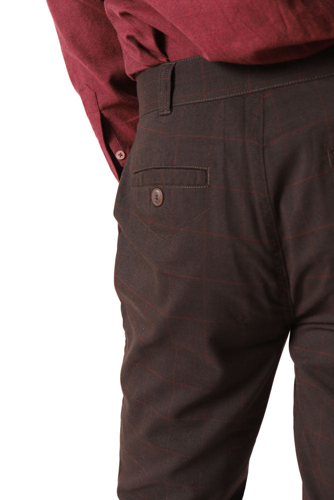 detail of the back of the dillon saville pant in brown with burgundy faint plaid