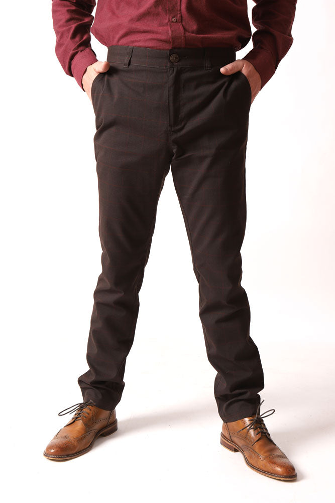 front view of dillon saville straight leg men's pant in brown, with hands in pockets