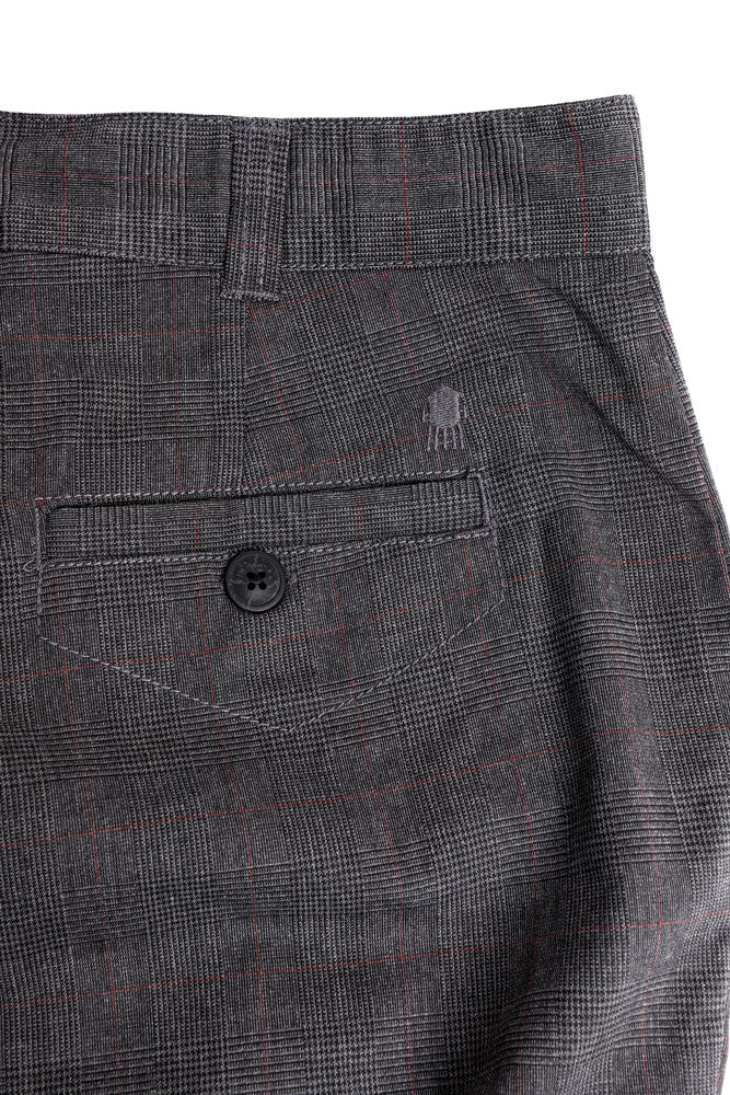 detail of water tower embroidery on the back pocket of men's dress pant in charcoal