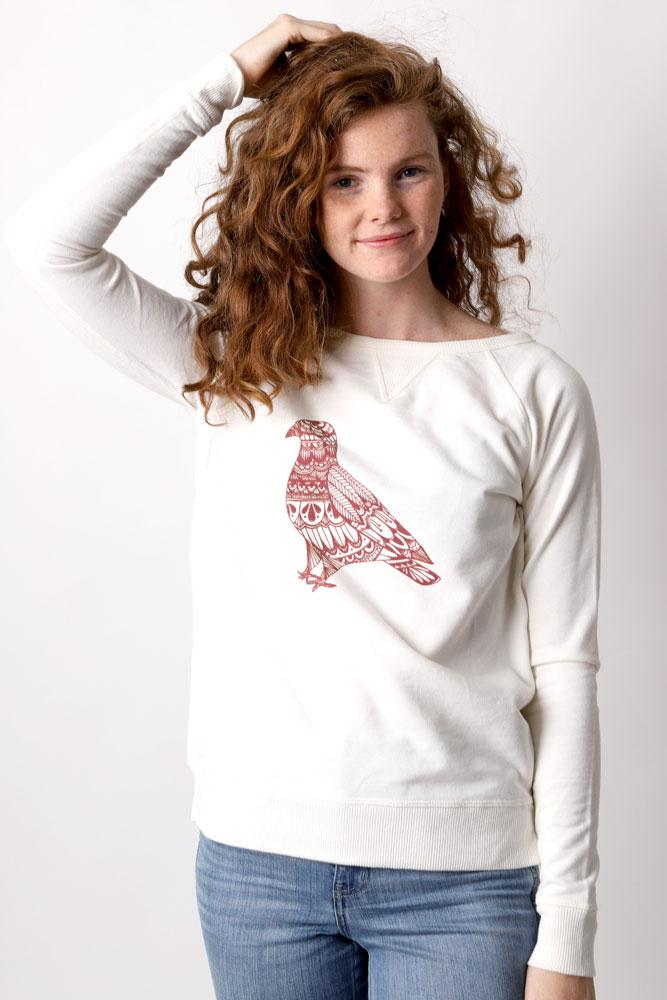 Women plays with hair in Doodle Pigeon sweatshirt