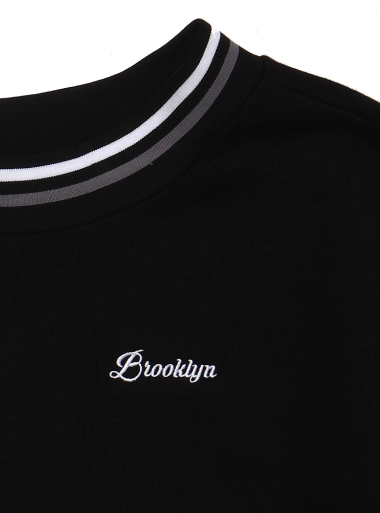 DETAIL OF THE EMBROIDERY ON THE BLACK BROOKLYN SWEATSHIRT