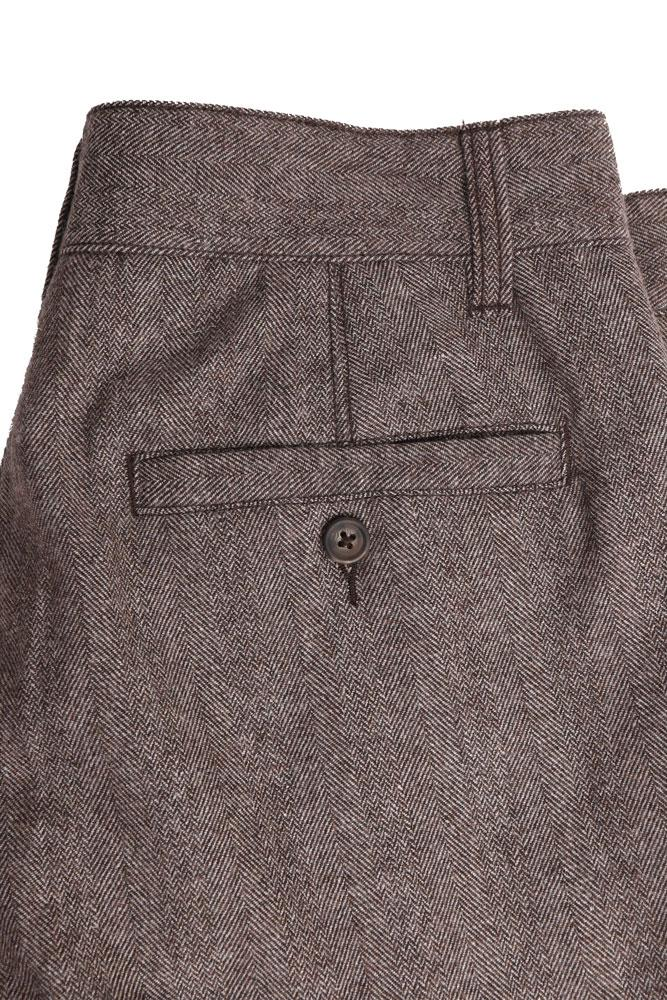detail of back pocket on brown wool pant