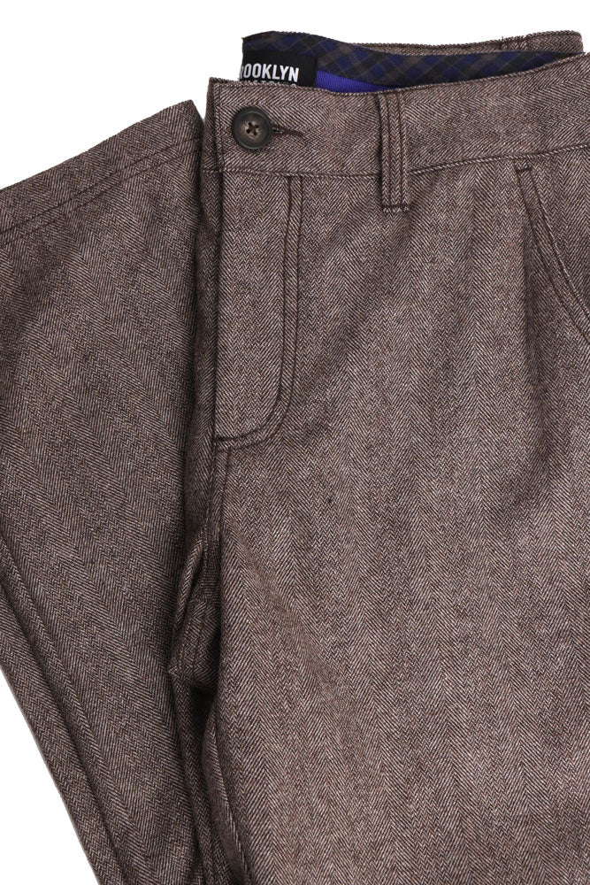 flat lay folded brown wool pant