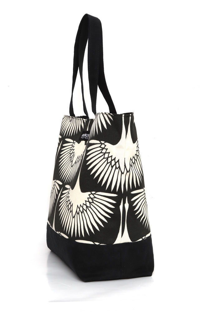 Large cotton canvas tote with waxed canvas handles and bottom.  black and white graphic bird pattern with black wax details, side view