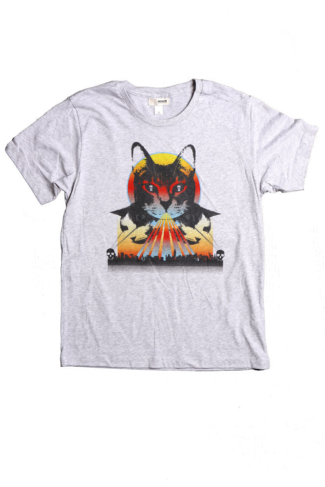 Flat lay men's t-shirt with graphic of demonic cat with skull eyes and a rainbow light surrounding it.