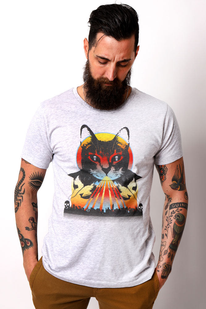 Man with tattoos and beard has hands in pockets, wearing Furrious graphic t-shirt