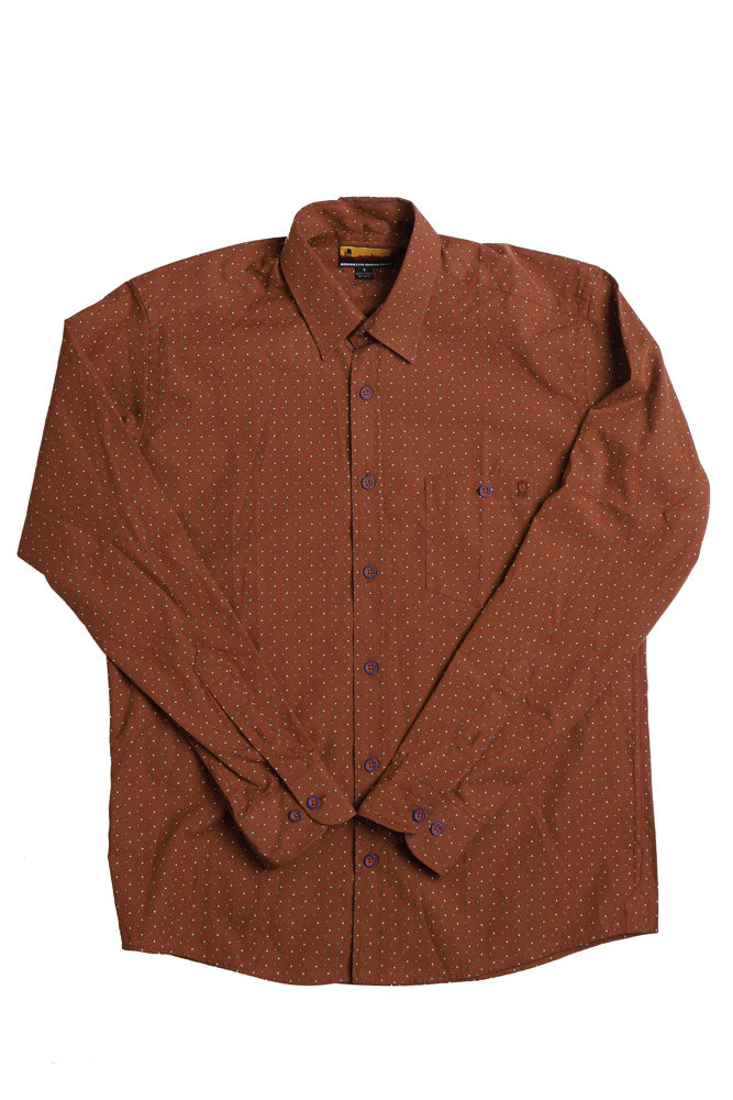 flat lay Men's long sleeved woven shirt, in a rusty brown tone, featuring blue white and red small graphic markings across the whole body. The front pocket features an embroidered brown water tower, and the buttons are a beautiful contrasting blue.