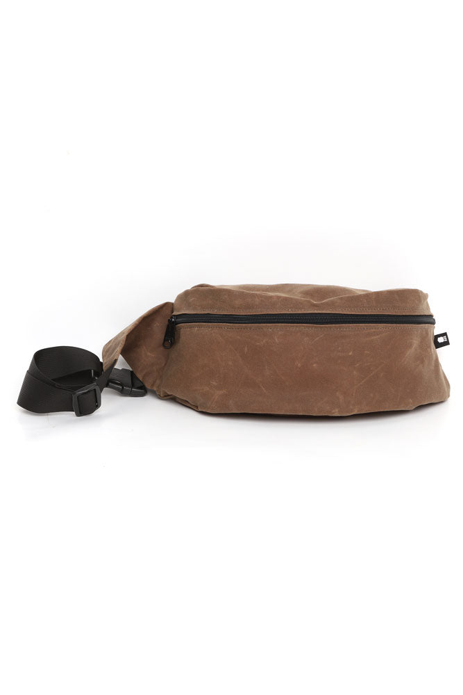 FRONT VIEW OF THE ZEKI WAISTPACK IN HAVANNA BROWN WAX CANVAS