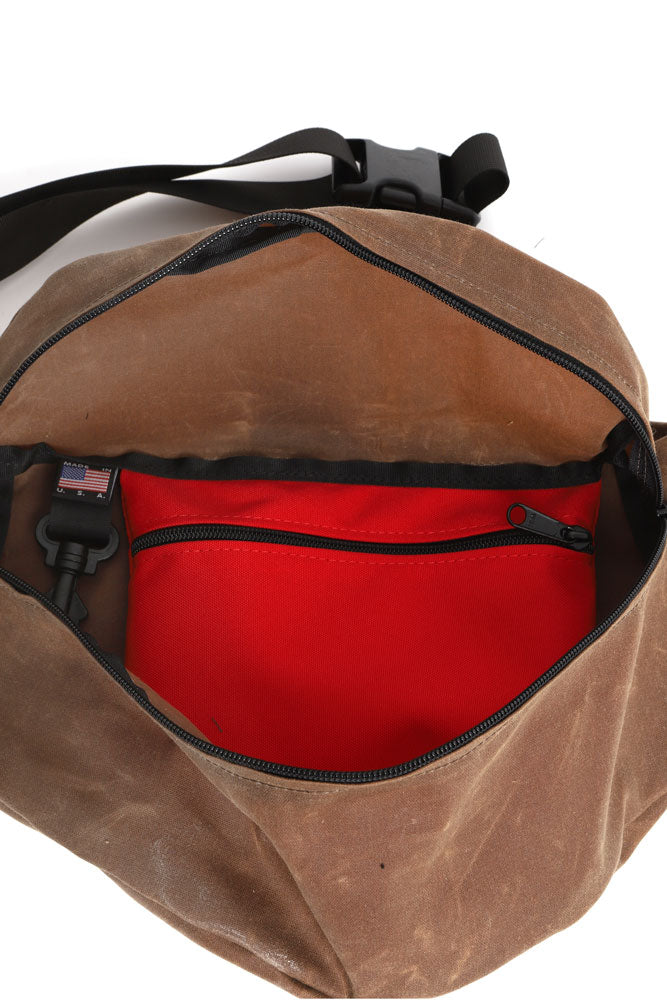 INSIDE VIEW OFTHE ZEKI WAISTPACK IN HAVANNA BROWN WAX CANVAS