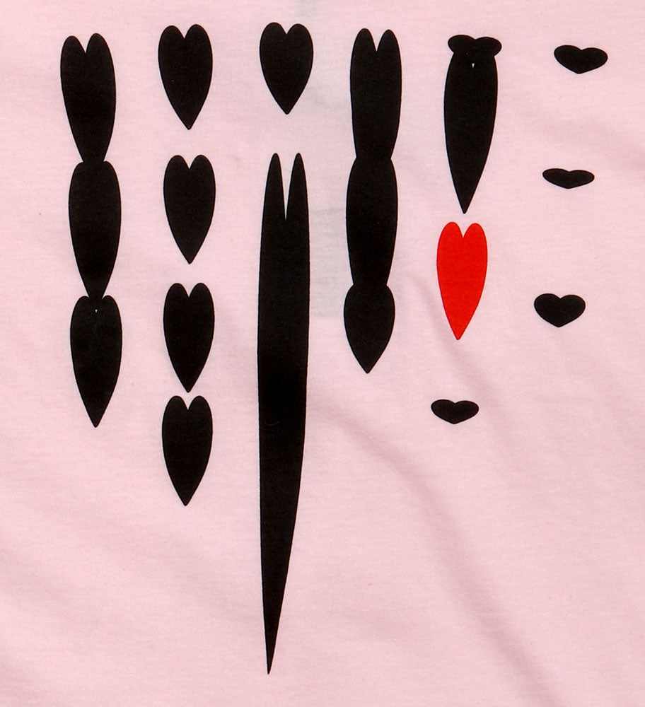 detail of dripping black hearts on light pink youth t-shirt