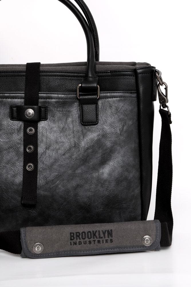 DETAIL OF THE FRONT OF THE JASPER ROLL TOP BRIEFCASE