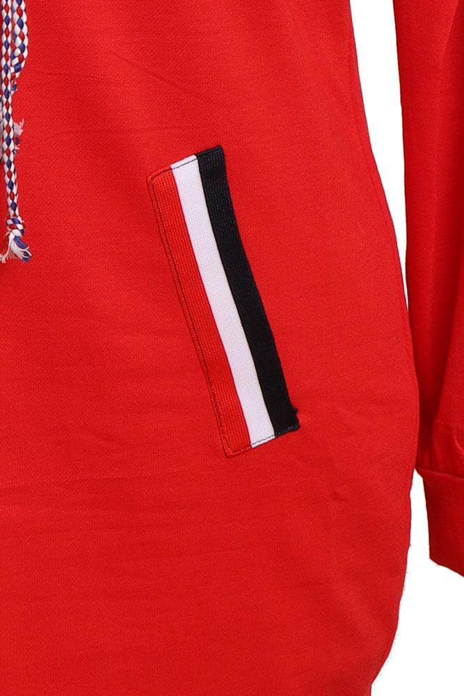 detail of faux pocket design in red white and blue on the red jumper dress