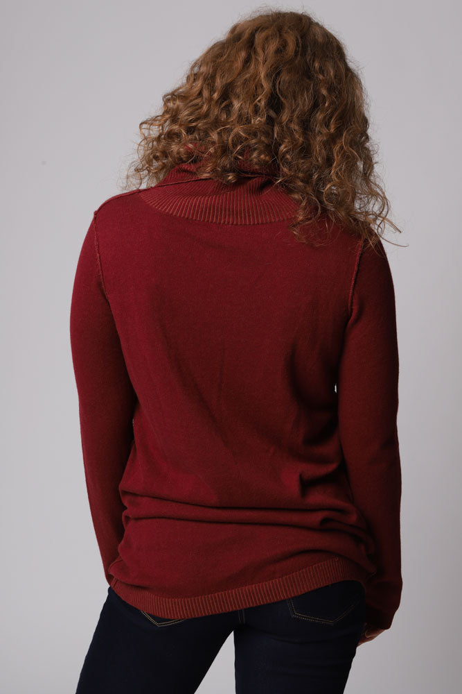 women in burgundy cowl neck sweater