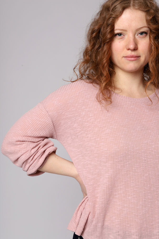 Knits so easy in this drapey rib knit long sleeve top with balloon sleeves. Slouchy fit, super soft and comfortable. In a mauve rose color.