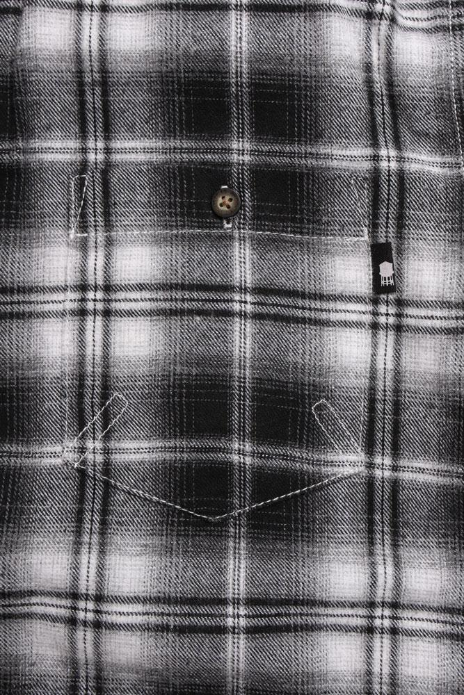 detail of front pocket is adorned with the black water tower tag, and the contrasting stitching