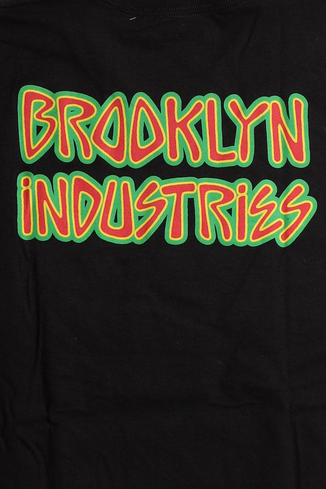 DETAIL OF BACK OF LIGHTENING T-SHIRT WITH BROOKLYN INDUSTRIES WRITTEN IN FUNKY FONT.