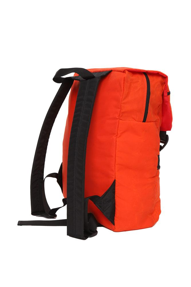 side and back view of Mass Backpack, with Brooklyn industries logo tag on front pocket, flip over top with contrasting lining, in orange waxed canvas