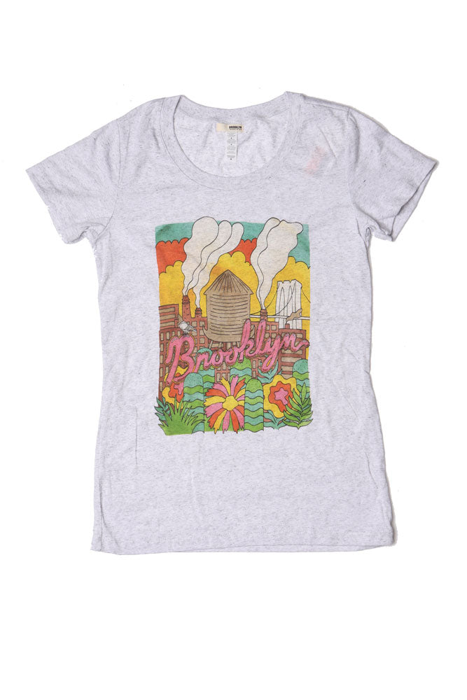Flat lay of a white fleck t-shirt with a design  of Colorful Watertower Cartoon like Image