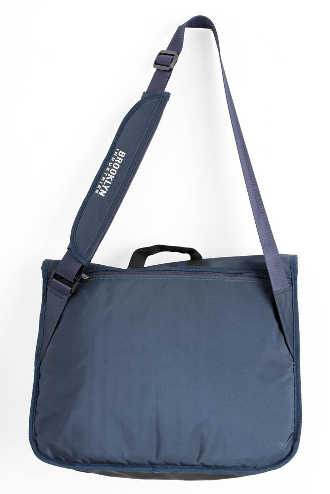 REFLEX MESSENGER BAG IN NAVY HANGING BACK VIEW
