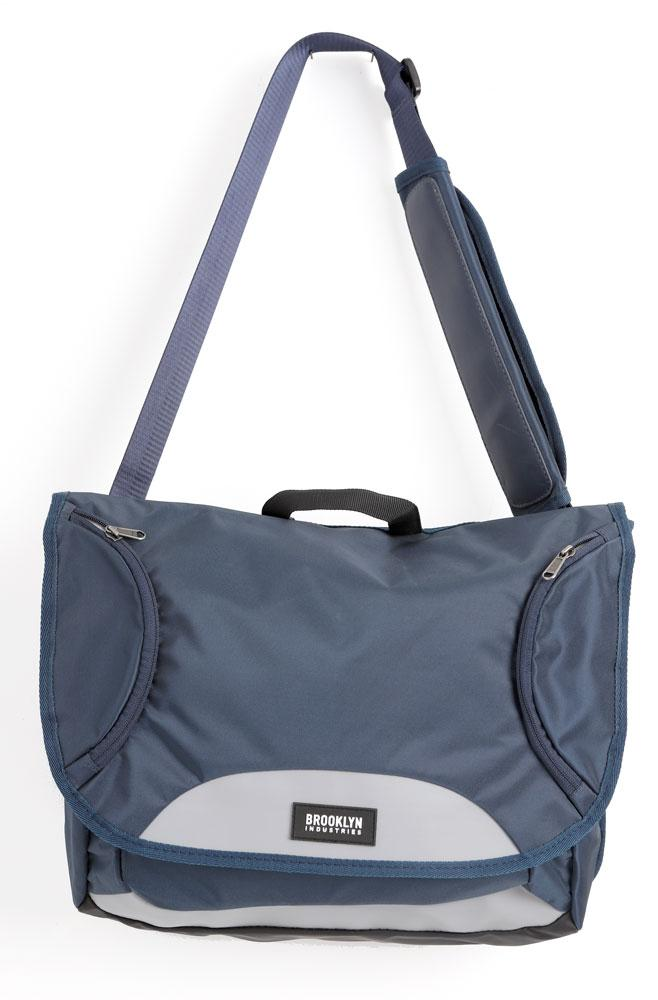 REFLEX MESSENGER BAG IN NAVY, HANGING FRONT VIEW