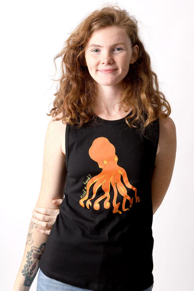 smiling women with hand behind her back wears black tank top with orange octopus graphic. 8 arms spell out Brooklyn