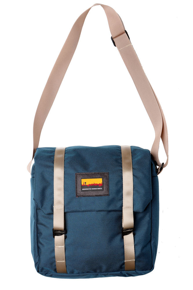 cross body style bag with a flip top and khaki webbing straps. flat lay image of the mail bag in old navy